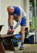 17 July 2020; Ciarán Ó Fearraigh of Ratoath laces his boots outside of the dressing room prior to the Meath County Senior Football League Division 1 Group C Round 1 match between Ratoath and Syddan at Sean Eiffe Park in Ratoath, Meath. Competitive GAA matches have been approved to return following the guidelines of Phase 3 of the Irish Government's Roadmap for Reopening of Society and Business and protocols set down by the GAA governing authorities. With games having been suspended since March, competitive games can take place with updated protocols including a limit of 200 individuals at any one outdoor event, including players, officials and a limited number of spectators, with social distancing, hand sanitisation and face masks being worn by those in attendance among other measures in an effort to contain the spread of the Coronavirus (COVID-19) pandemic. Photo by Seb Daly/Sportsfile