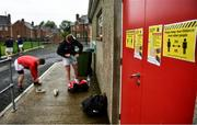 17 July 2020; Players put their boots on outside the closed dressing rooms prior to the 2020 Down GAA ACFL Division 4B match between St Michael's and East Belfast at St Michael's GAA Ground in Magheralin, Down. Competitive GAA matches have been approved to return following the guidelines of Northern Ireland's COVID-19 recovery plan and protocols set down by the GAA governing authorities. With games having been suspended since March, competitive games can take place with updated protocols with only players, officials and essential personnel permitted to attend, social distancing, hand sanitisation and face masks being worn by those in attendance in an effort to contain the spread of the Coronavirus (COVID-19) pandemic. Photo by David Fitzgerald/Sportsfile