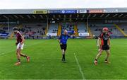 17 July 2020; Team captains Jack O'Connor of St Martin's, left, and Kevin Sheridan of Oulart the Ballagh after the coin toss with referee Justin Heffernan prior to the Wexford County Senior Hurling Championship Group A Round 1 match between Oulart the Ballagh and St Martin's at Chadwicks Wexford Park in Wexford. Competitive GAA matches have been approved to return following the guidelines of Phase 3 of the Irish Government's Roadmap for Reopening of Society and Business and protocols set down by the GAA governing authorities. With games having been suspended since March, competitive games can take place with updated protocols including a limit of 200 individuals at any one outdoor event, including players, officials and a limited number of spectators, with social distancing, hand sanitisation and face masks being worn by those in attendance among other measures in an effort to contain the spread of the Coronavirus (COVID-19) pandemic. Photo by Brendan Moran/Sportsfile