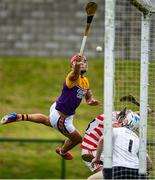 18 July 2020; Lee Chin of Faythe Harriers deflects a shot which goes narrowly wide during the Wexford County Senior Hurling Championship Group B Round 1 match between Ferns St Aidan's and Faythe Harriers at Bellefield in Enniscorthy, Wexford. Competitive GAA matches have been approved to return following the guidelines of Phase 3 of the Irish Government's Roadmap for Reopening of Society and Business and protocols set down by the GAA governing authorities. With games having been suspended since March, competitive games can take place with updated protocols including a limit of 200 individuals at any one outdoor event, including players, officials and a limited number of spectators, with social distancing, hand sanitisation and face masks being worn by those in attendance among other measures in an effort to contain the spread of the Coronavirus (COVID-19) pandemic. Photo by Eóin Noonan/Sportsfile