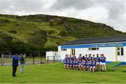 18 July 2020; Kilcar players stand for a team photograph prior to the Donegal County Divisional League Division 1 Section B match between Kilcar and Killybegs at Towney Park in Kilcar, Donegal. Competitive GAA matches have been approved to return following the guidelines of Phase 3 of the Irish Government's Roadmap for Reopening of Society and Business and protocols set down by the GAA governing authorities. With games having been suspended since March, competitive games can take place with updated protocols including a limit of 200 individuals at any one outdoor event, including players, officials and a limited number of spectators, with social distancing, hand sanitisation and face masks being worn by those in attendance among other measures in an effort to contain the spread of the Coronavirus (COVID-19) pandemic. Photo by Seb Daly/Sportsfile