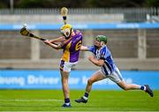 19 July 2020; Mark Grogan of Kilmacud Crokes in action against Conor McKeon of Ballyboden St Enda's during the Dublin County Senior Hurling Championship Round 1 match between Ballyboden St Enda's and Kilmacud Crokes at Parnell Park in Dublin. Competitive GAA matches have been approved to return following the guidelines of Phase 3 of the Irish Government's Roadmap for Reopening of Society and Business and protocols set down by the GAA governing authorities. With games having been suspended since March, competitive games can take place with updated protocols including a limit of 200 individuals at any one outdoor event, including players, officials and a limited number of spectators, with social distancing, hand sanitisation and face masks being worn by those in attendance among other measures in an effort to contain the spread of the Coronavirus (COVID-19) pandemic. Photo by Ramsey Cardy/Sportsfile