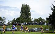 19 July 2020; A general view of the action as supporters watch on from outside the ground during the Armagh County Senior Football League Group A Round 1 match between Maghery Sean McDermotts and Crossmaglen Rangers at Felix Hamill Park in Maghery, Armagh. Competitive GAA matches have been approved to return following the guidelines of Northern Ireland's COVID-19 recovery plan and protocols set down by the GAA governing authorities. With games having been suspended since March, competitive games can take place with updated protocols with only players, officials and essential personnel permitted to attend, social distancing, hand sanitisation and face masks being worn by those in attendance in an effort to contain the spread of the Coronavirus (COVID-19) pandemic. Photo by Stephen McCarthy/Sportsfile