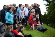 19 July 2020; Supporters watch on from outside the ground during the Armagh County Senior Football League Group A Round 1 match between Maghery Sean McDermotts and Crossmaglen Rangers at Felix Hamill Park in Maghery, Armagh. Competitive GAA matches have been approved to return following the guidelines of Northern Ireland's COVID-19 recovery plan and protocols set down by the GAA governing authorities. With games having been suspended since March, competitive games can take place with updated protocols with only players, officials and essential personnel permitted to attend, social distancing, hand sanitisation and face masks being worn by those in attendance in an effort to contain the spread of the Coronavirus (COVID-19) pandemic. Photo by Stephen McCarthy/Sportsfile