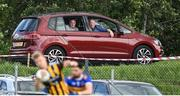 19 July 2020; Supporters watch on from their car outside the ground during the Armagh County Senior Football League Group A Round 1 match between Maghery Sean McDermotts and Crossmaglen Rangers at Felix Hamill Park in Maghery, Armagh. Competitive GAA matches have been approved to return following the guidelines of Northern Ireland's COVID-19 recovery plan and protocols set down by the GAA governing authorities. With games having been suspended since March, competitive games can take place with updated protocols with only players, officials and essential personnel permitted to attend, social distancing, hand sanitisation and face masks being worn by those in attendance in an effort to contain the spread of the Coronavirus (COVID-19) pandemic. Photo by Stephen McCarthy/Sportsfile
