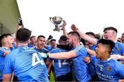 17 July 2020; St Joseph's SS players celebrate with the cup after the Leinster GAA Colleges Senior A Football Final match between Naas CBS and St Joseph's SS, Rochfortbridge at Bord na Móna O'Connor Park in Tullamore, Offaly. Competitive GAA matches have been approved to return following the guidelines of Phase 3 of the Irish Government's Roadmap for Reopening of Society and Business and protocols set down by the GAA governing authorities. With games having been suspended since March, competitive games can take place with updated protocols including a limit of 200 individuals at any one outdoor event, including players, officials and a limited number of spectators, with social distancing, hand sanitisation and face masks being worn by those in attendance among other measures in an effort to contain the spread of the Coronavirus (COVID-19) pandemic. Photo by Piaras Ó Mídheach/Sportsfile