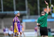 19 July 2020; Referee Aaron Murphy shows a red card to Oisin O'Rorke of Kilmacud Crokes during the Dublin County Senior Hurling Championship Round 1 match between Ballyboden St Enda's and Kilmacud Crokes at Parnell Park in Dublin. Competitive GAA matches have been approved to return following the guidelines of Phase 3 of the Irish Government's Roadmap for Reopening of Society and Business and protocols set down by the GAA governing authorities. With games having been suspended since March, competitive games can take place with updated protocols including a limit of 200 individuals at any one outdoor event, including players, officials and a limited number of spectators, with social distancing, hand sanitisation and face masks being worn by those in attendance among other measures in an effort to contain the spread of the Coronavirus (COVID-19) pandemic. Photo by Ramsey Cardy/Sportsfile