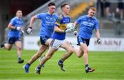 17 July 2020; Paddy McDermott of Naas CBS gets past Ciaran Daly, left, and Shane Fleming of St Joseph's SS during the Leinster GAA Colleges Senior A Football Final match between Naas CBS and St Joseph's SS, Rochfortbridge at Bord na Móna O'Connor Park in Tullamore, Offaly. Competitive GAA matches have been approved to return following the guidelines of Phase 3 of the Irish Government's Roadmap for Reopening of Society and Business and protocols set down by the GAA governing authorities. With games having been suspended since March, competitive games can take place with updated protocols including a limit of 200 individuals at any one outdoor event, including players, officials and a limited number of spectators, with social distancing, hand sanitisation and face masks being worn by those in attendance among other measures in an effort to contain the spread of the Coronavirus (COVID-19) pandemic. Photo by Piaras Ó Mídheach/Sportsfile