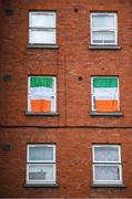 21 July 2020; Republic of Ireland flags hang from windows at The Iveagh Trust Kevin Street in Dublin during a rememberance for Jack Charlton on the day of his funeral in Newcastle, England. The former Republic of Ireland manager Jack Charlton lead the Republic of Ireland team to their first major finals at UEFA Euro 1988, and subsequently the FIFA World Cup 1990, in Italy, and the FIFA World Cup 1994, in USA.  Photo by Stephen McCarthy/Sportsfile