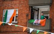 21 July 2020; A Republic of Ireland supporter, a resident at The Iveagh Trust Kevin Street in Dublin, hangs out a flag during a rememberance for Jack Charlton on the day of his funeral in Newcastle, England. The former Republic of Ireland manager Jack Charlton lead the Republic of Ireland team to their first major finals at UEFA Euro 1988, and subsequently the FIFA World Cup 1990, in Italy, and the FIFA World Cup 1994, in USA.  Photo by Stephen McCarthy/Sportsfile