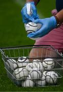 17 July 2020; St Martin's kitman Mick Reads sanitises sliotars during the Wexford County Senior Hurling Championship Group A Round 1 match between Oulart the Ballagh and St Martin's at Chadwicks Wexford Park in Wexford. Competitive GAA matches have been approved to return following the guidelines of Phase 3 of the Irish Government's Roadmap for Reopening of Society and Business and protocols set down by the GAA governing authorities. With games having been suspended since March, competitive games can take place with updated protocols including a limit of 200 individuals at any one outdoor event, including players, officials and a limited number of spectators, with social distancing, hand sanitisation and face masks being worn by those in attendance among other measures in an effort to contain the spread of the Coronavirus (COVID-19) pandemic. Photo by Brendan Moran/Sportsfile