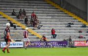 17 July 2020; Oulart the Ballagh substitutes sit in the stand during the Wexford County Senior Hurling Championship Group A Round 1 match between Oulart the Ballagh and St Martin's at Chadwicks Wexford Park in Wexford. Competitive GAA matches have been approved to return following the guidelines of Phase 3 of the Irish Government's Roadmap for Reopening of Society and Business and protocols set down by the GAA governing authorities. With games having been suspended since March, competitive games can take place with updated protocols including a limit of 200 individuals at any one outdoor event, including players, officials and a limited number of spectators, with social distancing, hand sanitisation and face masks being worn by those in attendance among other measures in an effort to contain the spread of the Coronavirus (COVID-19) pandemic. Photo by Brendan Moran/Sportsfile