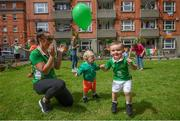 21 July 2020; Residents at The Iveagh Trust Kevin Street in Dublin, from left, Kristin Hawthorne Reid with her son Max and fellow Iveagh Trust Kevin Street resident Oscar Burton during a rememberance for Jack Charlton on the day of his funeral in Newcastle, England. The former Republic of Ireland manager Jack Charlton lead the Republic of Ireland team to their first major finals at UEFA Euro 1988, and subsequently the FIFA World Cup 1990, in Italy, and the FIFA World Cup 1994, in USA.  Photo by Stephen McCarthy/Sportsfile
