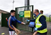 23 July 2020; David Wolfe of Patrickswell has his ticket checked on arrival by Steward Dave McGuinness  ahead of the Limerick County Senior Hurling Championship Round 1 match between Patrickswell and Adare at LIT Gaelic Grounds in Limerick. Competitive GAA matches have been approved to return following the guidelines of Phase 3 of the Irish Government's Roadmap for Reopening of Society and Business and protocols set down by the GAA governing authorities. With games having been suspended since March, competitive games can take place with updated protocols including a limit of 200 individuals at any one outdoor event, including players, officials and a limited number of spectators, with social distancing, hand sanitisation and face masks being worn by those in attendance among other measures in an effort to contain the spread of the Coronavirus (COVID-19). Photo by Sam Barnes/Sportsfile