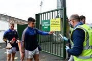 23 July 2020; Jason Gillane of Patrickswell has his ticket checked on arrival by Steward Dave McGuinness  ahead of the Limerick County Senior Hurling Championship Round 1 match between Patrickswell and Adare at LIT Gaelic Grounds in Limerick. Competitive GAA matches have been approved to return following the guidelines of Phase 3 of the Irish Government's Roadmap for Reopening of Society and Business and protocols set down by the GAA governing authorities. With games having been suspended since March, competitive games can take place with updated protocols including a limit of 200 individuals at any one outdoor event, including players, officials and a limited number of spectators, with social distancing, hand sanitisation and face masks being worn by those in attendance among other measures in an effort to contain the spread of the Coronavirus (COVID-19). Photo by Sam Barnes/Sportsfile