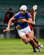 23 July 2020; Aaron Gillane of Patrickswell breaks away from David Connolly of Adare on his way to scoring his side's second goal during the Limerick County Senior Hurling Championship Round 1 match between Patrickswell and Adare at LIT Gaelic Grounds in Limerick. Competitive GAA matches have been approved to return following the guidelines of Phase 3 of the Irish Government's Roadmap for Reopening of Society and Business and protocols set down by the GAA governing authorities. With games having been suspended since March, competitive games can take place with updated protocols including a limit of 200 individuals at any one outdoor event, including players, officials and a limited number of spectators, with social distancing, hand sanitisation and face masks being worn by those in attendance among other measures in an effort to contain the spread of the Coronavirus (COVID-19). Photo by Sam Barnes/Sportsfile