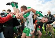 30 June 2013; Lorcan Mulvey, London, lifts team-mate Shane Mulligan, as they celebrate victory after the game. Connacht GAA Football Senior Championship, Semi-Final Replay, Leitrim v London, Hyde Park, Roscommon. Picture credit: Barry Cregg / SPORTSFILE