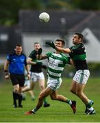 24 July 2020; Fiachra Lynch of Valley Rovers in action against Kieran Histon of Nemo Rangers during the Cork County Premier Senior Football Championship Group C Round 1 match between Valley Rovers and Nemo Rangers at Cloughduv GAA grounds in Cloughduv, Cork. GAA matches continue to take place in front of a limited number of people in an effort to contain the spread of the coronavirus (Covid-19) pandemic. Photo by David Fitzgerald/Sportsfile