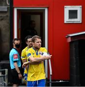 24 July 2020; Longford Town captain Dean Zambra puts on the captains armband after leaving the dressing room ahead of the club friendly match between Bohemians and Longford Town at Dalymount Park in Dublin. Soccer matches continue to take place in front of a limited number of people in an effort to contain the spread of the coronavirus (Covid-19) pandemic. Photo by Ramsey Cardy/Sportsfile