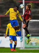 24 July 2020; Lido Lotefa of Longford Town in action against Kris Twardek of Bohemians during the club friendly match between Bohemians and Longford Town at Dalymount Park in Dublin. Soccer matches continue to take place in front of a limited number of people in an effort to contain the spread of the coronavirus (Covid-19) pandemic. Photo by Ramsey Cardy/Sportsfile