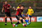 24 July 2020; Andy Lyons of Bohemians in action against Lido Lotefa of Longford Town during the club friendly match between Bohemians and Longford Town at Dalymount Park in Dublin. Soccer matches continue to take place in front of a limited number of people in an effort to contain the spread of the coronavirus (Covid-19) pandemic. Photo by Ramsey Cardy/Sportsfile