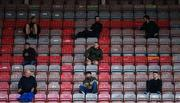 24 July 2020; Supporters sit socially distanced in The Jodi Stand during the club friendly match between Bohemians and Longford Town at Dalymount Park in Dublin. Soccer matches continue to take place in front of a limited number of people in an effort to contain the spread of the coronavirus (Covid-19) pandemic. Photo by Ramsey Cardy/Sportsfile