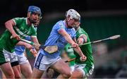 24 July 2020; William Heen of Na Piarsaigh is tackled by Mark O'Loughlin, left, and Philip O'Loughlin of Kilmallock during the Limerick County Senior Hurling Championship Round 1 match between Kilmallock and Na Piarsaigh at LIT Gaelic Grounds in Limerick. GAA matches continue to take place in front of a limited number of people in an effort to contain the spread of the coronavirus (Covid-19) pandemic. Photo by Piaras Ó Mídheach/Sportsfile