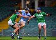 24 July 2020; Kevin Downes of Na Piarsaigh in action against Mark O'Loughlin, left, and Gavin O'Mahony of Kilmallock during the Limerick County Senior Hurling Championship Round 1 match between Kilmallock and Na Piarsaigh at LIT Gaelic Grounds in Limerick. GAA matches continue to take place in front of a limited number of people in an effort to contain the spread of the coronavirus (Covid-19) pandemic. Photo by Piaras Ó Mídheach/Sportsfile