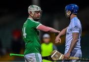 24 July 2020; Robbie Egan of Kilmallock with Padraic Kennedy of Na Piarsaigh after the Limerick County Senior Hurling Championship Round 1 match between Kilmallock and Na Piarsaigh at LIT Gaelic Grounds in Limerick. GAA matches continue to take place in front of a limited number of people in an effort to contain the spread of the coronavirus (Covid-19) pandemic. Photo by Piaras Ó Mídheach/Sportsfile