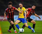 24 July 2020; Niall Barnes of Longford Town in action against Andy Lyons, left, and Keith Buckley of Bohemians during the club friendly match between Bohemians and Longford Town at Dalymount Park in Dublin. Soccer matches continue to take place in front of a limited number of people in an effort to contain the spread of the coronavirus (Covid-19) pandemic. Photo by Ramsey Cardy/Sportsfile