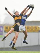 24 July 2020; Adrian Spillane of Templenoe fields a kickout ahead of Mark O'Shea of Dr Crokes during the Kerry County Senior Club Football Championship Group 1 Round 1 match between Dr Crokes and Templenoe at Fitzgerald Stadium in Killarney, Kerry. GAA matches continue to take place in front of a limited number of people in an effort to contain the spread of the coronavirus (Covid-19) pandemic. Photo by Brendan Moran/Sportsfile