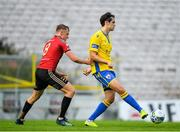 24 July 2020; Sam Verdon of Longford Town in action against JJ Lunney of Bohemians during the club friendly match between Bohemians and Longford Town at Dalymount Park in Dublin. Soccer matches continue to take place in front of a limited number of people in an effort to contain the spread of the coronavirus (Covid-19) pandemic. Photo by Ramsey Cardy/Sportsfile