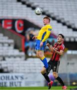 24 July 2020; Luke Dennison of Longford Town in action against Dawson Devoy of Bohemians during the club friendly match between Bohemians and Longford Town at Dalymount Park in Dublin. Soccer matches continue to take place in front of a limited number of people in an effort to contain the spread of the coronavirus (Covid-19) pandemic. Photo by Ramsey Cardy/Sportsfile