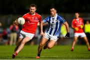 25 July 2020; Jack McCaffrey of Clontarf in action against Colm Basquel of Ballyboden St Enda's during the Dublin County Senior Football Championship Round 1 match between Ballyboden St Endas and Clontarf at Pairc Uí Mhurchu in Dublin. GAA matches continue to take place in front of a limited number of people in an effort to contain the spread of the Coronavirus (COVID-19) pandemic. Photo by David Fitzgerald/Sportsfile