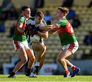 25 July 2020; James O'Donoghue of Killarney Legion is tackled by Sean O'Leary, left, and Paul O'Riordan of Kilcummin during the Kerry County Senior Club Football Championship Group 2 Round 1 match between Kilcummin and Killarney Legion at Lewis Road in Killarney, Kerry. GAA matches continue to take place in front of a limited number of people in an effort to contain the spread of the Coronavirus (COVID-19) pandemic. Photo by Brendan Moran/Sportsfile