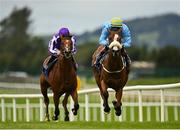 26 July 2020; Coill Avon, right, with Colin Keane up, races away from eventual second place St Mark's Basilica, with Wayne Lordan up, on their way to winning the Irish Stallion Farms EBF (C & G) Maiden at The Curragh Racecourse in Kildare. Racing remains behind closed doors to the public under guidelines of the Irish Government in an effort to contain the spread of the Coronavirus (COVID-19) pandemic. Photo by Seb Daly/Sportsfile