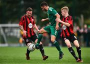 26 July 2020; Jordan Buckley of Usher Celtic in action against Conor Casserly, right, and Jonathan Savage of Gorey Rangers during the FAI New Balance Junior Cup Quarter-Final match between Usher Celtic and Gorey Rangers at Grangegorman IT in Dublin. Competitive Soccer matches have been approved to return following the guidelines of Phase 3 of the Irish Government's Roadmap for Reopening of Society and Business and protocols set down by the Soccer governing authorities. With games having been suspended since March, competitive games can take place with updated protocols including a limit of 200 individuals at any one outdoor event, including players, officials and a limited number of spectators, with social distancing, hand sanitisation and face masks being worn by those in attendance among other measures in an effort to contain the spread of the Coronavirus (COVID-19). Photo by Sam Barnes/Sportsfile
