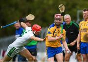 26 July 2020; Ronan O'Meara of Portumna in action against Kenneth Cooney of Sarsfields during the Galway County Senior Club Hurling Championship Group 3 Round 1 match between Sarsfields and Portumna at Kenny Park in Athenry, Galway. GAA matches continue to take place in front of a limited number of people in an effort to contain the spread of the Coronavirus (COVID-19) pandemic. Photo by David Fitzgerald/Sportsfile