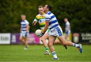 26 July 2020; Roland Whelton of Castlehaven in action against Darragh Hayes of Carbery Rangers during the Cork County Premier Senior Football Championship Group B Round 1 match between Castlehaven and Carbery Rangers Clonakilty in Cork. GAA matches continue to take place in front of a limited number of people in an effort to contain the spread of the Coronavirus (COVID-19) pandemic. Photo by Brendan Moran/Sportsfile