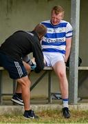 26 July 2020; Conor Cahalane of Castlehaven is attended to by a physio after the Cork County Premier Senior Football Championship Group B Round 1 match between Castlehaven and Carbery Rangers Clonakilty in Cork. GAA matches continue to take place in front of a limited number of people in an effort to contain the spread of the Coronavirus (COVID-19) pandemic. Photo by Brendan Moran/Sportsfile