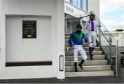 28 July 2020; Jockeys Gary Halpin, left, and Kevin Manning walk to the parade ring prior to the COLM QUINN BMW Irish EBF Fillies Maiden on day two of the Galway Summer Racing Festival at Ballybrit Racecourse in Galway. Horse racing remains behind closed doors to the public under guidelines of the Irish Government in an effort to contain the spread of the Coronavirus (COVID-19) pandemic. Photo by Harry Murphy/Sportsfile