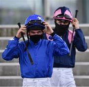 28 July 2020; Jockeys Gary Carroll, left, and Gary Halpin walk to the parade ring prior to the COLM QUINN BMW Mile Handicap on day two of the Galway Summer Racing Festival at Ballybrit Racecourse in Galway. Horse racing remains behind closed doors to the public under guidelines of the Irish Government in an effort to contain the spread of the Coronavirus (COVID-19) pandemic. Photo by Harry Murphy/Sportsfile