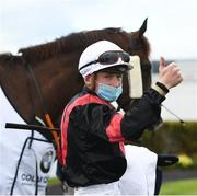 28 July 2020; Jockey Gavin Ryan with Saltonstall in the winner's enclosure after victory in the COLM QUINN BMW Mile Handicap on day two of the Galway Summer Racing Festival at Ballybrit Racecourse in Galway. Horse racing remains behind closed doors to the public under guidelines of the Irish Government in an effort to contain the spread of the Coronavirus (COVID-19) pandemic. Photo by Harry Murphy/Sportsfile