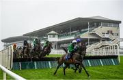 29 July 2020; A general view as runners and riders jump the fourth fence during the Irish Stallion Farms EBF Mares Handicap Hurdle on day three of the Galway Summer Racing Festival at Ballybrit Racecourse in Galway. Horse racing remains behind closed doors to the public under guidelines of the Irish Government in an effort to contain the spread of the Coronavirus (COVID-19) pandemic.  Photo by Harry Murphy/Sportsfile