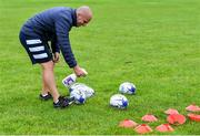 30 July 2020; Coach Niall Kane sanitises rugby balls before a Leinster U18 Girls Squad Training session at Cill Dara RFC in Kildare. during a Leinster U18 Girls Squad Training session at Cill Dara RFC in Kildare. Photo by Piaras Ó Mídheach/Sportsfile