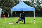 30 July 2020; Danielle Loughnane is treated by physio Lee Van Haeften during a Leinster U18 Girls Squad Training session at Cill Dara RFC in Kildare. Photo by Piaras Ó Mídheach/Sportsfile