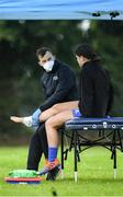 30 July 2020; Vicky Kinlan is treated by physio Lee Van Haeften during a Leinster U18 Girls Squad Training session at Cill Dara RFC in Kildare. Photo by Piaras Ó Mídheach/Sportsfile