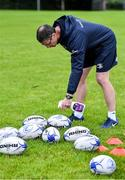 30 July 2020; Coach Damien McCabe sanitises rugby balls before a Leinster U18 Girls Squad Training session at Cill Dara RFC in Kildare. Photo by Piaras Ó Mídheach/Sportsfile