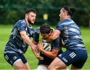 30 July 2020; Max Deegan is tackled by James Lowe and Robbie Henshaw, left, during Leinster Rugby squad training at UCD in Dublin. Professional rugby continues its return in a phased manner, having been suspended since March due to the Irish Government's efforts to contain the spread of the Coronavirus (COVID-19) pandemic. Having had zero positive results from the latest round of PCR testing, the Leinster Rugby players and staff have been cleared to enter the next phase of their return to rugby today which includes a graduated return to contact training. Photo by Conor Sharkey for Leinster Rugby via Sportsfile