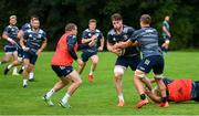 30 July 2020; Ryan Baird is tackled by Scott Penny during Leinster Rugby squad training at UCD in Dublin. Professional rugby continues its return in a phased manner, having been suspended since March due to the Irish Government's efforts to contain the spread of the Coronavirus (COVID-19) pandemic. Having had zero positive results from the latest round of PCR testing, the Leinster Rugby players and staff have been cleared to enter the next phase of their return to rugby today which includes a graduated return to contact training. Photo by Conor Sharkey for Leinster Rugby via Sportsfile